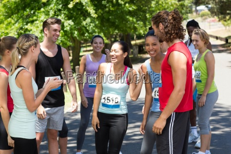 runners chatting after race in park