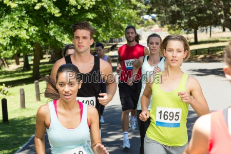 fit people running race in park