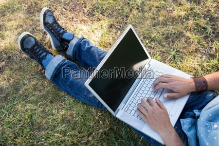 young man using laptop in the