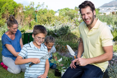 happy young family gardening together