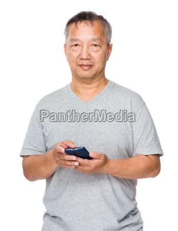 asian old man use of mobile