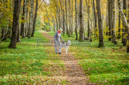 woman with dog walking in the