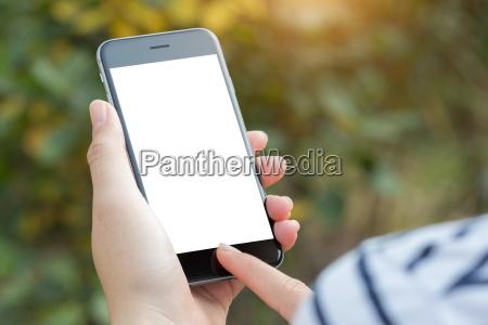 close up hand using phone white