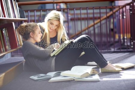 two female students learning in a