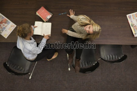 two female students in a library