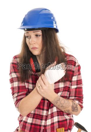 female artisan with a bandaged hand