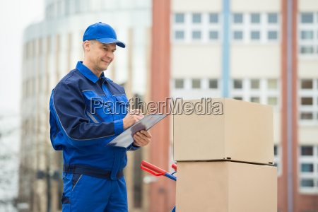 portrait of delivery man with parcels