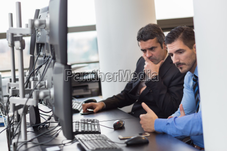 concerned stock traders in trading office
