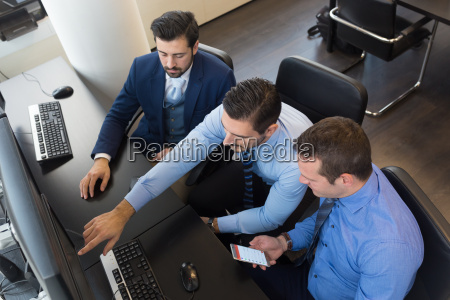 business team analyzing data on computer