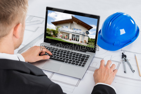 architect looking at computer in office