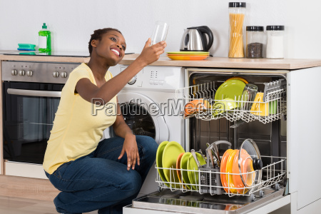 happy african woman looking at clean