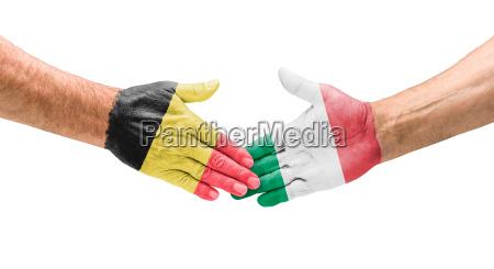 football teams handshake between belgium
