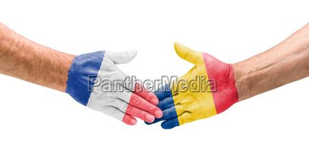 football teams handshake between france