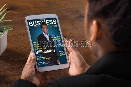 businesswoman reading online magazine on digital
