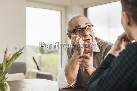 portrait of senior man communicating with
