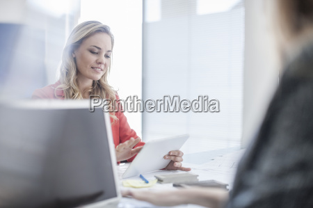 woman in office looking at digital