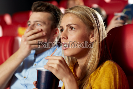 friends watching horror movie in theater