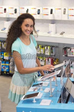 woman browsing digital tablets in phone