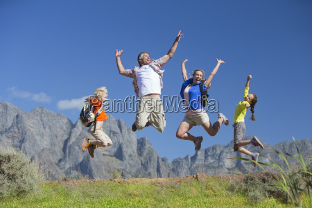 family jumping in the air on