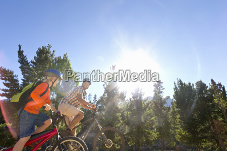 father and son mountain biking on