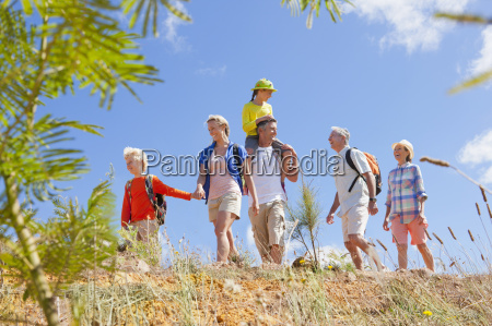 multi generation family hiking in countryside
