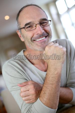 portrait of mature man with eyeglasses