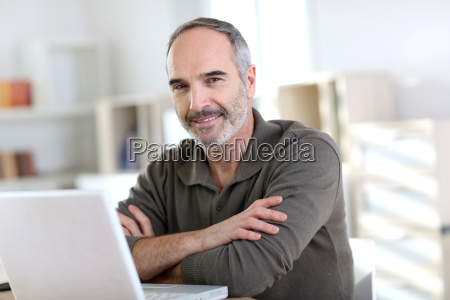 senior man working from home with