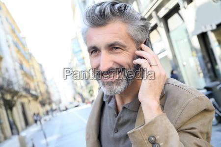 mature man talking on the phone