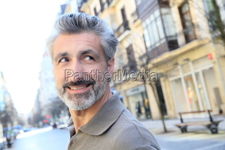 handsome mature man standing in the