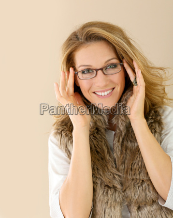 attrative trendy mature woman with eyeglasses
