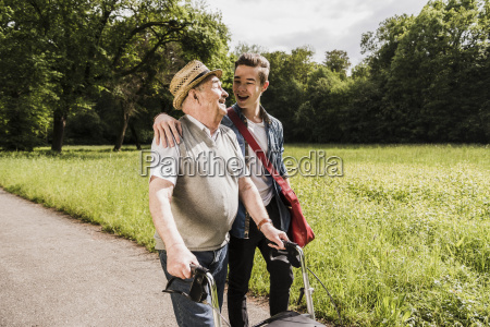 happy grandfather walking with his grandson