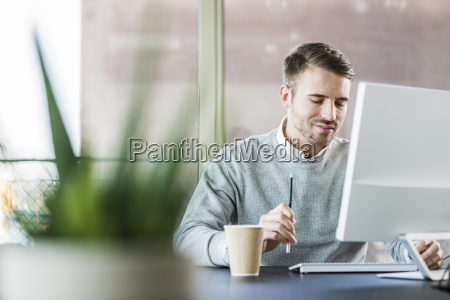young man at office desk