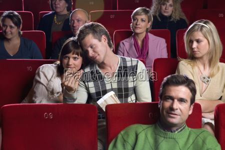jealous woman watching couple in movie