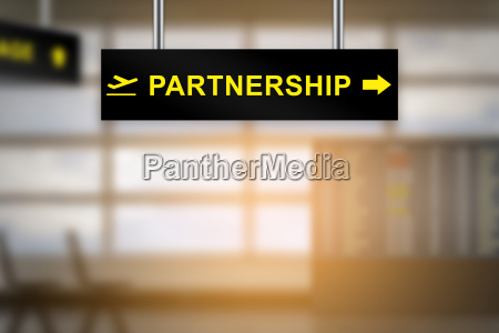 partnership on airport sign board