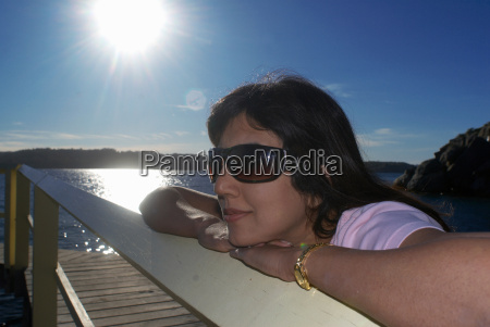 woman relaxing by boat house