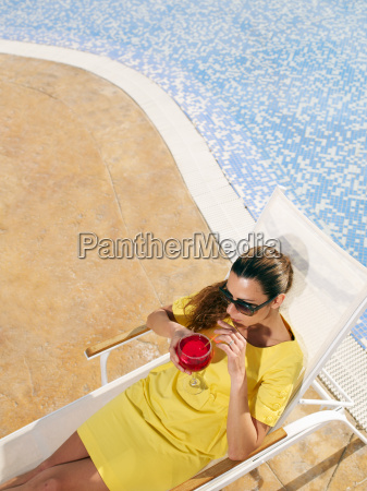 woman relaxing on sun lounger by
