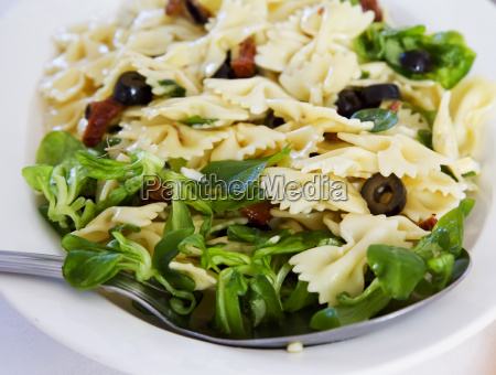 cold pasta in white plate
