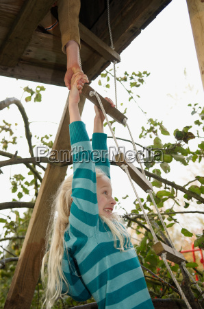 boy helping girl to treehouse