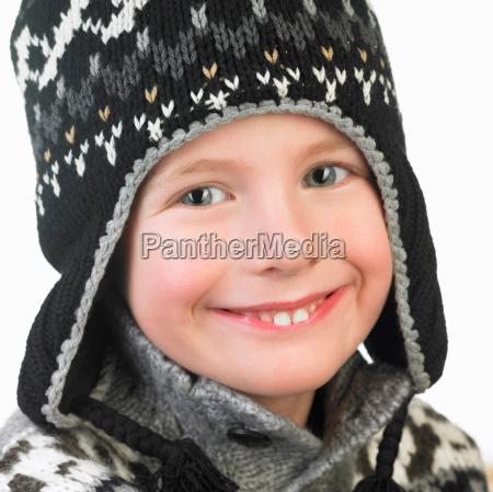 boy wearing a winter hat