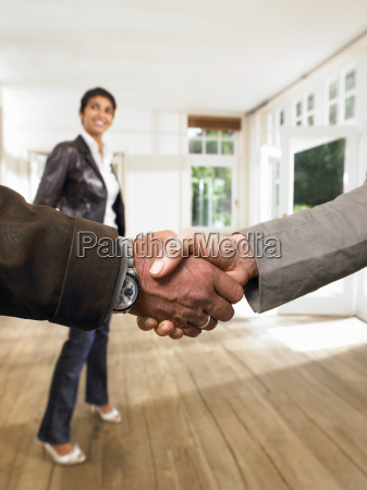 shake hands in front of smiling