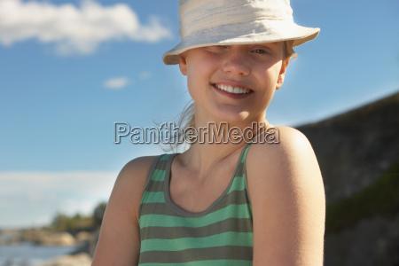 young woman wearing sun hat