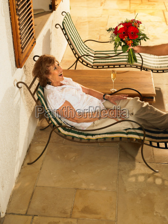 senior woman lying on sun lounger