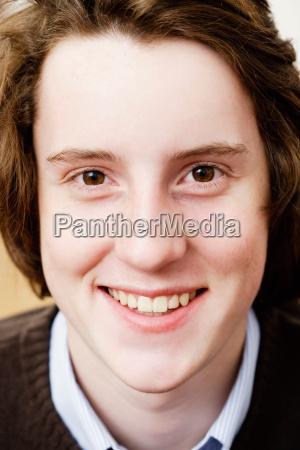 teenage boy looking to camera