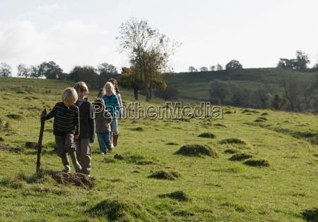 children walking in field