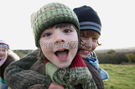 two boys playing in field