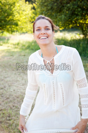 portrait of woman smiling in countryside