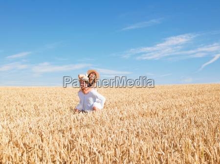 young, couple, in, wheat, field - 18274364