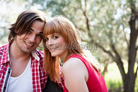 young couple leaning heads together