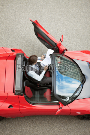 business man working near electric car