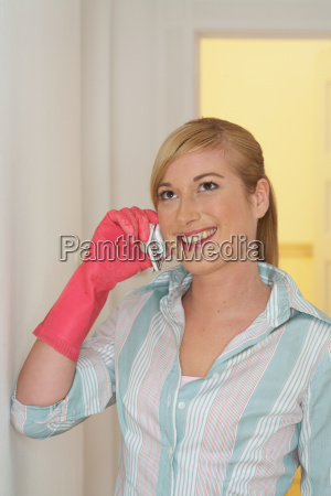 young woman wearing rubber glove
